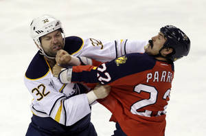 Photo - Florida Panthers' George Parros (22) brawls wiith Buffalo Sabres' John Scott (32) in the first period of an NHL hockey game in Sunrise, Fla., Thursday, Feb. 28, 2013. (AP Photo/Alan Diaz)