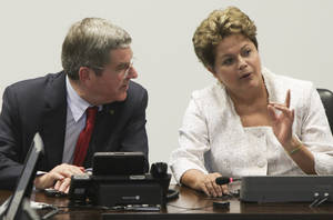 Photo - International Olympic Committee (IOC) President Thomas Bach, left, speaks with Brazil's President Dilma Rousseff during a meeting at Planalto Palace in Brasilia, Brazil, Tuesday, Jan. 21, 2014. The city of Rio de Janeiro will host the Olympics in 2016. (AP Photo/Joel Rodrigues)