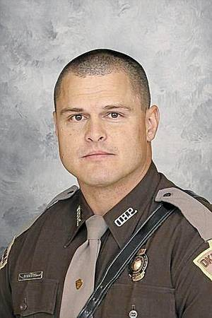 Photo - OHP Trooper Eric Roberts. Image via Tulsa World.