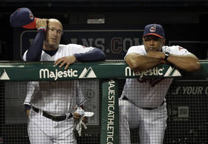 Photo -   FILE - This Aug. 27, 2012 file photo shows Cleveland Indians manager Manny Acta, left, and bench coach Sandy Alomar, Jr., watching from the dugout in the eighth inning of a 3-0 loss to the Oakland Athletics, in Cleveland. The Indians have fired Acta after the team collapsed from contention. The Indians announced Acta will not return in 2013 on Thursday, Sept. 27, 2012, an off day before opening their final homestand. (AP Photo/Mark Duncan, File)