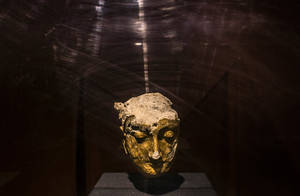 Photo - The gilded head of a Buddha statue from some 1,500 years ago is displayed inside a case at the National Museum of Afghanistan. Mauricio Lima for The New York Times