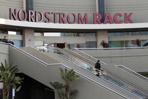photo - Police secure the scene at the Nordstrom Rack store at Westchester Mall in Los Angeles, where LAPD SWAT officers rescued 14 people who were hiding in a storage room following an armed robbery, Friday, Jan. 11, 2013. Employees were closing up the store and preparing to go home when two gunmen stormed inside and took them hostage. The thugs stabbed one of the 14 Nordstrom Rack employees and sexually assaulted another before SWAT officers freed everyone early Friday, more than three hours after the ordeal began. (AP Photo/Los Angeles Times, Irfan Khan)  NO FORNS; NO SALES; MAGS OUT; ORANGE COUNTY REGISTER OUT; LOS ANGELES DAILY NEWS OUT; VENTURA COUNTY STAR OUT; INLAND VALLEY DAILY BULLETIN OUT; MANDATORY CREDIT, TV OUT