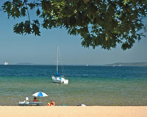 Photo - This undated photo released by the Traverse City Convention & Visitors Bureau shows West End Beach in Traverse City, one of many free-of-charge beaches on Lake Michigan's Grand Traverse Bay. (AP Photo/Traverse City Convention & Visitors Bureau)