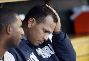 Photo -   New York Yankees' Alex Rodriguez watches from the bench during Game 4 of the American League championship series against the Detroit Tigers Thursday, Oct. 18, 2012, in Detroit. (AP Photo/Paul Sancya )