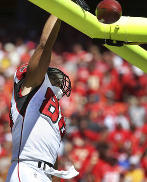 Photo -   Atlanta Falcons tight end Tony Gonzalez (88) celebrates his touchdown during the second half of an NFL football game against the Kansas City Chiefs at Arrowhead Stadium in Kansas City, Mo., Sunday, Sept. 9, 2012. (AP Photo/Ed Zurga)