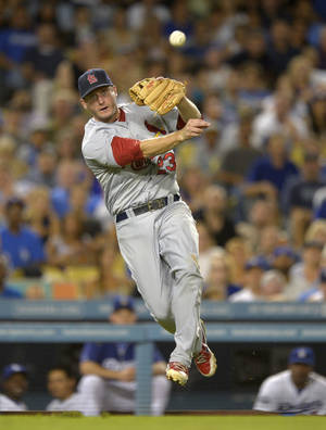 Photo -   St. Louis Cardinals third baseman David Freese attempts to throw out Los Angeles Dodgers' Nick Punto at first during the sixth inning of their baseball game, Friday, Sept. 14, 2012, in Los Angeles. Punto was safe at first on the play. (AP Photo/Mark J. Terrill)