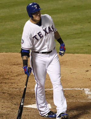 photo -   Texas Rangers' Josh Hamilton grimaces after striking out in the seventh inning of a baseball game against the Cleveland Indians, Wednesday, Sept. 12, 2012, in Arlington, Texas. Hamilton did not take the field in the eighth inning due to left knee soreness in the 5-2 Rangers win. (AP Photo/Tony Gutierrez)
