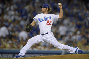 Photo - Los Angeles Dodgers starting pitcher Clayton Kershaw throws in the second inning of Game 4 in the National League baseball division series against the Atlanta Braves, Monday, Oct. 7, 2013, in Los Angeles. (AP Photo/Mark J. Terrill) <strong>Mark J. Terrill</strong>