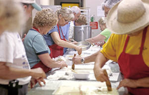 Photo - Angela Angelidis works with others on Sept. 1 making Baklava at St. George's Greek Orthodox Church in Oklahoma City. Photo by Bryan Terry, The Oklahoman