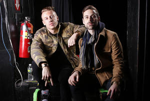 "Photo - This Nov. 20, 2012 file photo shows Ben Haggerty, better known by his stage name Macklemore, left, and his producer Ryan Lewis at Irving Plaza in New York. The rapper Macklemore thinks there's a simple reason his hit ""Thrift Shop"" appears to be going viral: It dares to be different. The Seattle-based duo has sold 2.3 million copies so far _ a million in the last month alone _ and sales continue to grow week to week. (Photo by Carlo Allegri/Invision)"