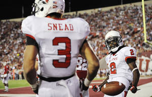 Photo -   Ball State wide receiver Jamill Smith (2) celebrates a touchdown by wide receiver Willie Snead (3) against Indiana during an NCAA college football game in Bloomington, Ind., Saturday, Sept. 15, 2012. (AP Photo/The Herald-Times, Chris Howell)
