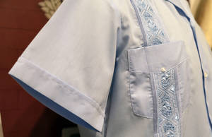 "photo -   In this Wednesday, Oct. 17, 2012 photo, a guayabera made in Mexico in 2012 featuring machine made embroidery, is on display at an exhibition titled ""The Guayabera: A Shirt's Story"" at the Museum of History Miami, in Miami. This is the first exhibition to trace the story of the shirt's evolution through Cuba, Mexico, and the United States. (AP Photo/Lynne Sladky)"