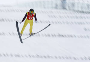 Photo - Bill Demong of the United States makes his jump during a men's Nordic combined, large hill, training session at the 2014 Winter Olympics, Monday, Feb. 17, 2014, in Krasnaya Polyana, Russia. (AP Photo/Dmitry Lovetsky)