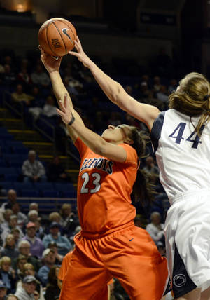 photo - Illinois' Alexis Smith (23) and Penn State's Tori Waldner (44) reach for a rebound during the second half of an NCAA college basketball game in State College, Pa., Wednesday, Feb. 20, 2013. Penn State won 95-62. (AP Photo/Ralph Wilson)