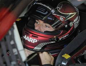 Photo - Jeff Gordon waits in his car before practice for Sunday's NASCAR Sprint Cup series Coca-Cola 600 auto race at Charlotte Motor Speedway in Concord, N.C., Saturday, May 24, 2014. (AP Photo/Mike McCarn)