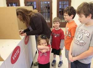 Photo - Michelle Trant and her children Anneke, 3, Sam, 5, Alex, 8, and Ben, 10, votes at Holy Trinity Lutheran Church in Edmond at precinct 40, Tuesday , March 6, 2012. Photo by David McDaniel,