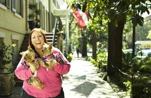 "Photo - In this publicity image released by the  Style Network, reality TV star  Ruby Gettinger, of the  Style Network's "" Ruby,"" holds her dogs Foxy and Lucy. AP Photo"