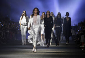 Photo -   Models walk in the finale of the Prabal Gurung Spring 2013 collection, during Fashion Week in New York, Saturday, Sept. 8, 2012. (AP Photo/Richard Drew)