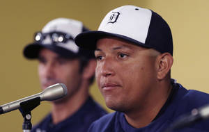 Photo - Detroit Tigers first baseman Miguel Cabrera is seen during a news conference where the details of Cabrera's eight-year contract extension was officially announced in Lakeland, Fla., Friday, March 28, 2014. (AP Photo/Carlos Osorio)