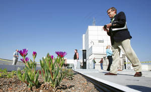 Photo - David Retzsch, a Dallas landscape architect, attends an open house Thursday for the vegetative roof system atop the National Weather Center at the University of Oklahoma campus. photo by Steve Sisney,  The Oklahoman