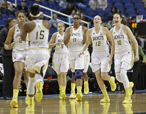Photo - Georgia Tech players Katarina Vuckovic (10), Frida Fogdemark (12), Nariah Taylor (11), and Kymberly Ellison (5), run to teammate Tyaunna Marshall (15) at the end of an NCAA college basketball game against Virginia at the Atlantic Coast Conference tournament in Greensboro, N.C., Thursday, March 6, 2014. Georgia Tech won 77-76. (AP Photo/Chuck Burton)