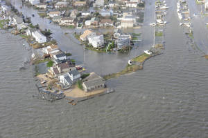 Photo -   This image provided by the U.S. Coast Guard shows storm damage from Superstorm Sandy in a portion of New Haven Conn. taken during an overflight with Coast Guard Air Station Cape Cod, Mass, following Hurricane Sandy Wednesday Oct. 30, 2012. (AP Photo/US Coast Guard, Petty Officer 2nd Class Rob Simpson)