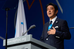 Photo - Japan's Prime Minister Shinzo Abe, addresses the International Olympic Committee session during the Tokyo 2020 bid presentation in  Buenos Aires, Argentina, Saturday, Sept. 7, 2013. (AP Photo/Fabrice Coffrini, Pool)