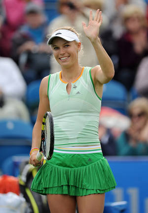 Photo - Caroline Wozniacki of Denmark celebrates defeating Samantha Stosur of Australia at the Aegon International tennis tournament at Devonshire Park, Eastbourne, England, Monday June 16, 2014. (AP Photo/PA, Clive Gee) UNITED KINGDOM OUT  NO SALES  NO ARCHIVE