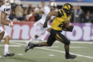 Photo - Missouri running back Henry Josey (20) goes in for a touchdown against Oklahoma State during the second half of the Cotton Bowl NCAA college football game, Friday, Jan. 3, 2014, in Arlington, Texas. (AP Photo/Brandon Wade)
