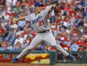 Photo - Los Angeles Dodgers starting pitcher Zack Greinke throws to the Philadelphia Phillies during the first inning of a baseball game on Friday, Aug. 16, 2013, in Philadelphia. (AP Photo/Christopher Szagola)