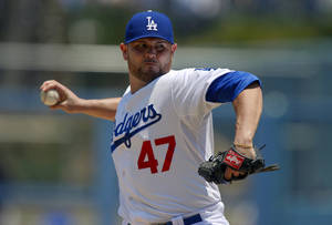 Photo - Los Angeles Dodgers starting pitcher Ricky Nolasco throws to the plate during the first inning of their baseball game against the Colorado Rockies, Sunday, July 14, 2013, in Los Angeles. (AP Photo/Mark J. Terrill)