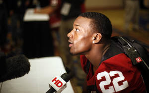 Photo - OU / COLLEGE FOOTBALL: Oklahoma's Roy Finch (22) talks with the media during a University of Oklahoma media day for the Insight Bowl at the Camelback Inn in Paradise Valley, Ariz.,  Wednesday, Dec. 28, 2011. Photo by Sarah Phipps, The Oklahoman