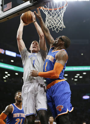 Photo - New York Knicks' Amare Stoudemire (1) blocks a shot by Brooklyn Nets' Mason Plumlee (1) during the first half of an NBA basketball game Tuesday, April 15, 2014, in New York. (AP Photo/Frank Franklin II)