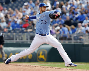 Photo - Kansas City Royals starting pitcher James Shields delivers to a Chicago White Sox batter during the first inning of a baseball game at Kauffman Stadium in Kansas City, Mo., Sunday, April 6, 2014. (AP Photo/Orlin Wagner)