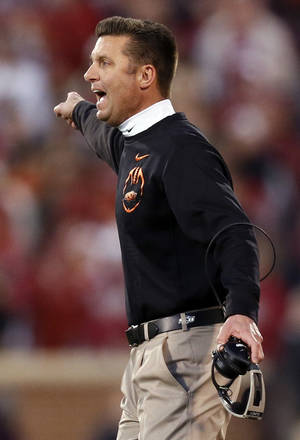 Photo - OSU head coach Mike Gundy yells at an official during the Bedlam college football game between the University of Oklahoma Sooners (OU) and the Oklahoma State University Cowboys (OSU) at Gaylord Family-Oklahoma Memorial Stadium in Norman, Okla., Saturday, Nov. 24, 2012. OU won, 51-48 in overtime. Photo by Nate Billings , The Oklahoman