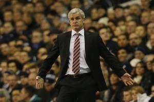 Photo - Stoke City's manager Mark Hughes gestures as he watches his team play against Tottenham Hotspur during their English Premier League soccer match at White Hart Lane, London, Sunday, Dec. 29, 2013. (AP Photo/Sang Tan)