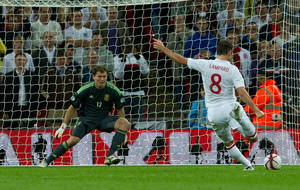 Photo -   England's Frank Lampard, right, scores from the penalty spot during their group H 2014 World Cup qualifying soccer match against Ukraine at Wembley stadium, London, Tuesday, Sept. 11, 2012. (AP Photo/Tom Hevezi)