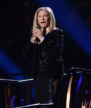 Photo - FILE - This Oct. 11, 2012 file photo shows singer Barbra Streisand performing at the Barclays Center in the Brooklyn borough of  New York. The Academy of Motion Picture Arts and Sciences announced Wednesday that the 70-year-old singing veteran will hit the stage on Feb. 24. It will be her second performance at the Oscars, and her first in 36 years. (Photo by Evan Agostini/Invision/AP, file)