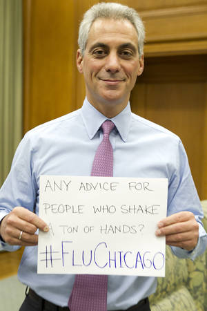 "Photo - In this photo provided by the office of the mayor and posted to his Twitter account on Friday, Jan. 11, 2013, Chicago Mayor Rahm Emanuel holds a sign asking, ""Any advice for people who shake a ton of hands?"" The photo was tweeted during a Twitter chat held by the city's Department of Health to answer questions. To answer, Dr. Julie Morita of the health department replied via Twitter: ""My advice is to wash your hands frequently and have hand sanitizer readily available!"" (AP Photo/Courtesy The Mayors Office, Brooke Collins)"
