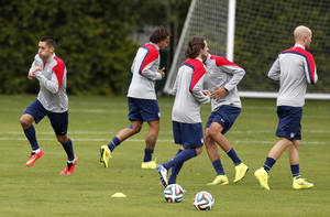 Photo - United States' Clint Dempsey works out during a training session in Sao Paulo, Brazil, Friday, June 20, 2014. The U.S. will play against Portugal in group G of the 2014 soccer World Cup on June 22. (AP Photo/Julio Cortez)