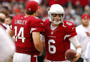 Photo - Arizona Cardinals quarterback Brian Hoyer (6) replaces teammate Ryan Lindley during the second half of an NFL football game, Sunday, Dec. 23, 2012, in Glendale, Ariz. (AP Photo/Rick Scuteri)