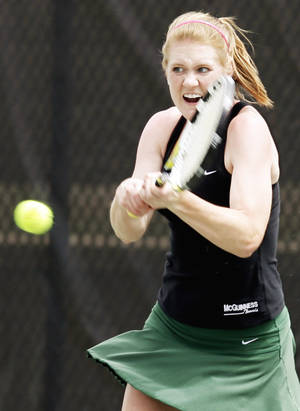 Photo - Emily Conrad of Bishop McGuinness competes in the Class 5A girls No. 2 singles final Saturday at the Oklahoma City Tennis Center. Photo by Nate Billings, The Oklahoman