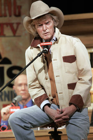 Photo - Radio personality Don Imus addresses the audience at New York's Town Hall during his return to radio in this 2007 photo.  AP PHOTO