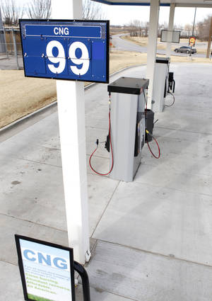 photo - CNG dropped below a dollar Monday at the OnCue Express at 1 NW 23 St. in Oklahoma City Photo By Paul Hellstern,  The Oklahoman
