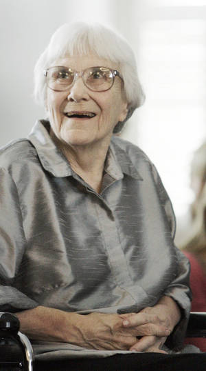 "Photo - FILE - In this Aug. 20, 2007, file photo, author Harper Lee smiles during a ceremony honoring the four new members of the Alabama Academy of Honor at the Capitol in Montgomery, Ala. ""To Kill a Mockingbird"" will be made available as an e-book and digital audiobook in July 2014, filling one of the biggest gaps in the electronic library. Author Harper Lee said in a rare public statement Monday, April 28, 2014, issued through HarperCollins Publishers, that while she still favored ""dusty"" books she had signed on for making ""Mockingbird"" available to a ""new generation."" (AP Photo/Rob Carr, File)"