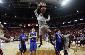 photo - San Diego State's Jamaal Franklin dunks during the second half of a Mountain West Conference tournament NCAA college basketball game on Wednesday, March 13, 2013, in Las Vegas. San Diego State defeated Boise State 73-67. (AP Photo/Isaac Brekken)
