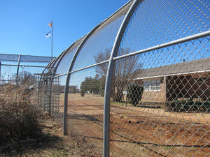 Photo -  A fence surrounds the Central Oklahoma Juvenile Center in Tecumseh. Photo by Carla Hinton, The Oklahoman  <strong></strong>