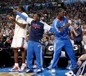 Photo - Serge Ibaka, Nate Robinson and Royal Ivey are part of the Thunder's supportive bench crew. Photo by Bryan Terry, The Oklahoman