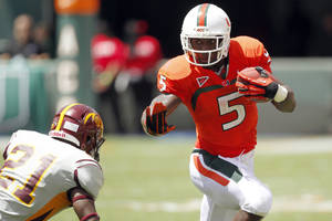 photo -   FILE - In this Sept. 15, 2012, file photo, Miami running back Mike James (5) runs against Bethune-Cookman defensive back Tim Burke (21) during the first half of an NCAA college football game in Miami. The last time the Hurricanes played the Irish, his mother's funeral coincided with kickoff. James said Notre Dame didn't see his best that day _ but vows the Irish will when the teams meet in Chicago on Saturday. (AP Photo/Wilfredo Lee, File)