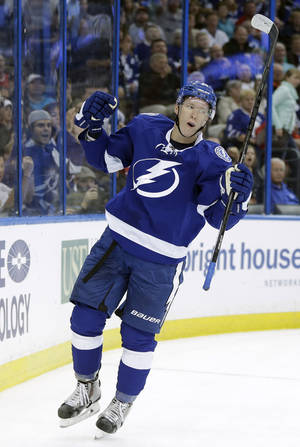 Photo - Tampa Bay Lightning left wing Ondrej Palat (18), of the Czech Republic, celebrates after scoring against the Toronto Maple Leafs during the second period of an NHL hockey game Tuesday, April 8, 2014, in Tampa, Fla. (AP Photo/Chris O'Meara)